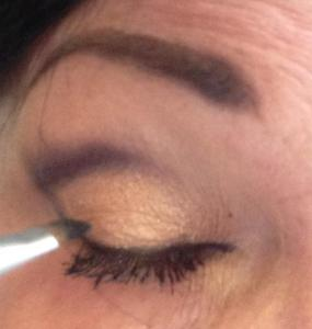 softening the liquid eyeliner with powder