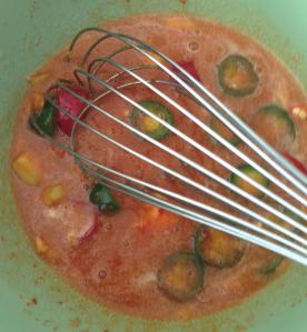 whisking the marinade