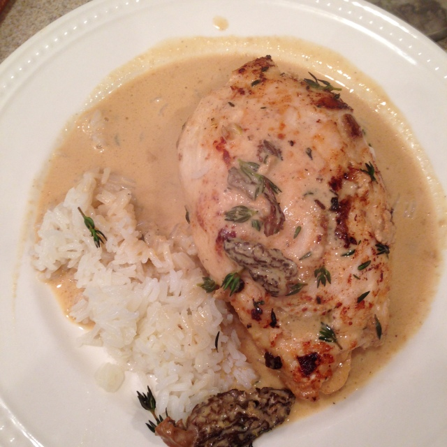 Chicken plated with sauce and served wiwth Jasmine rice