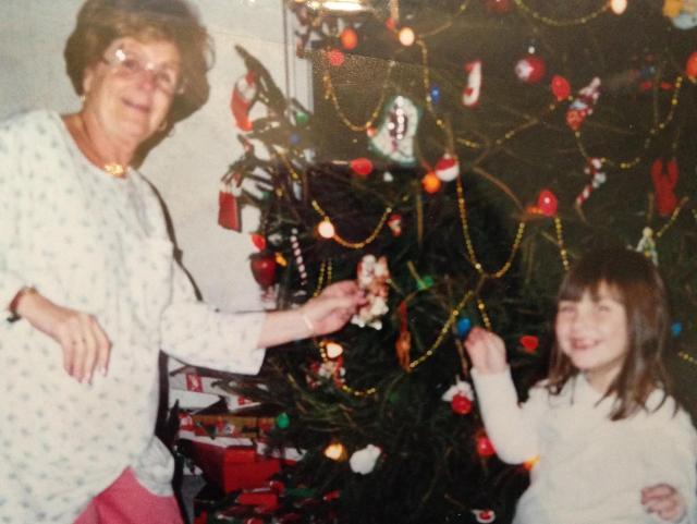Mom and Oona decoratin the tree