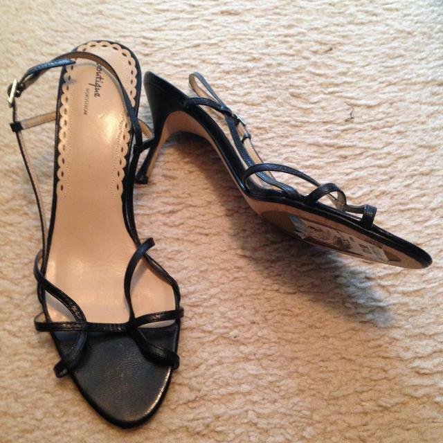 Ten year old strappy black sandals. They still have the price on the bottom.