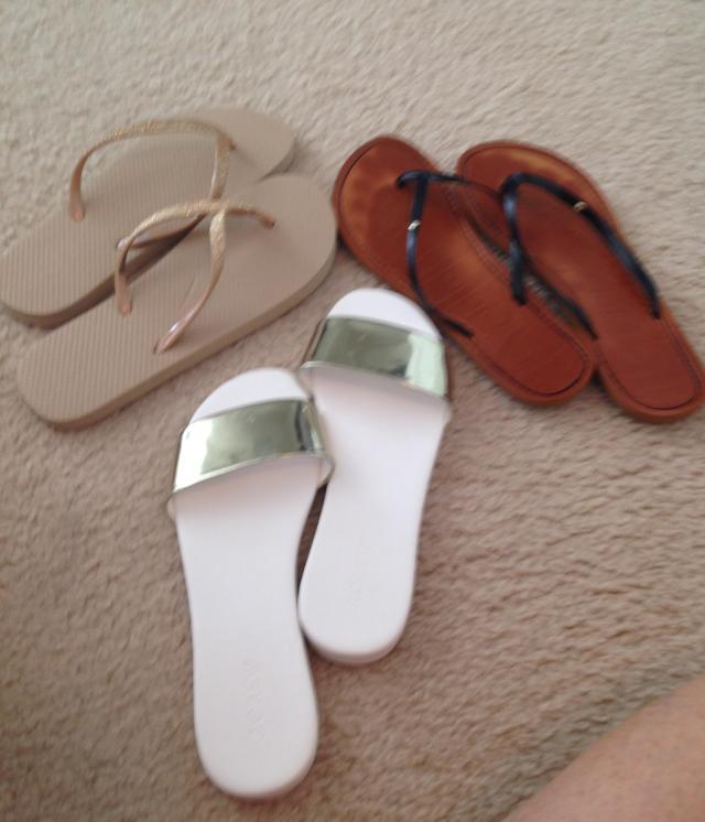 some summer flip flops and slides