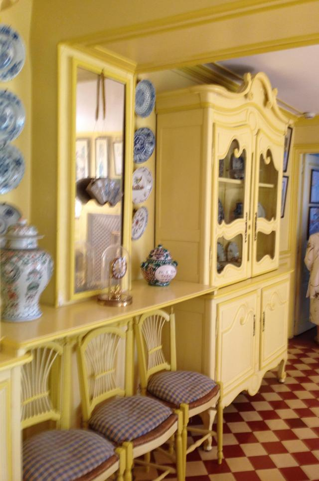 Giverny. Another view of bright yellow kitchen.