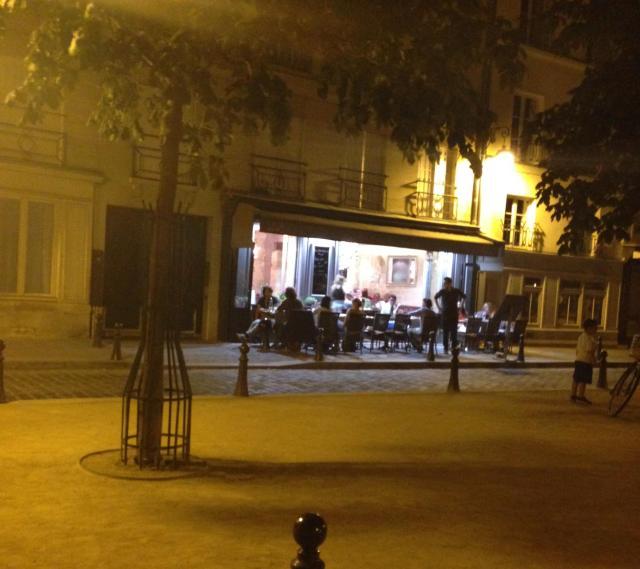 Paris. Place Dauphine. One light up bar, empty corner