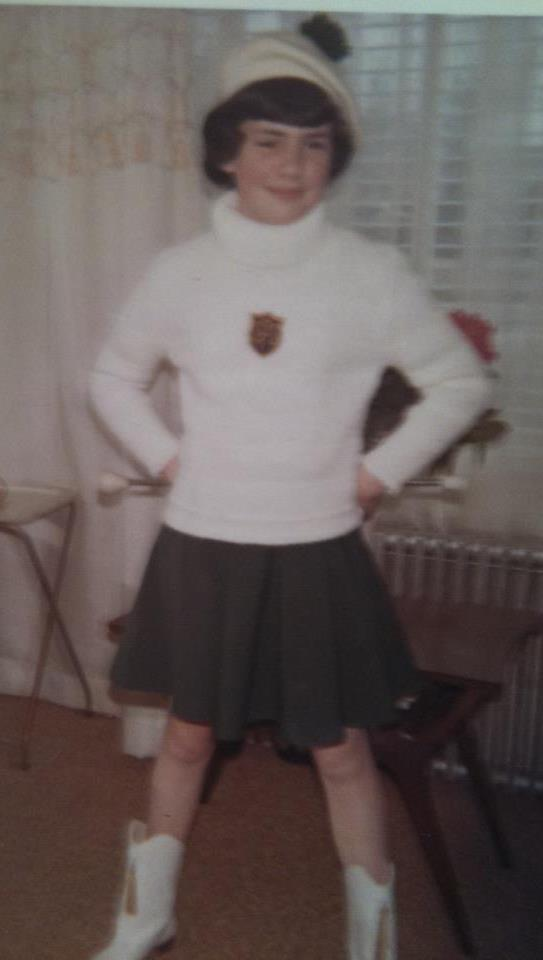Me. St. Pat's twirler. My legs were so thin!! But the unibrow was setting in!
