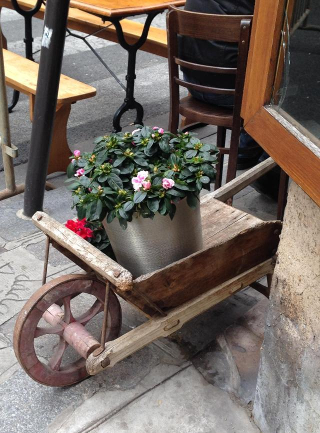 Paris. Cute Wheelbarrow outside of bistro