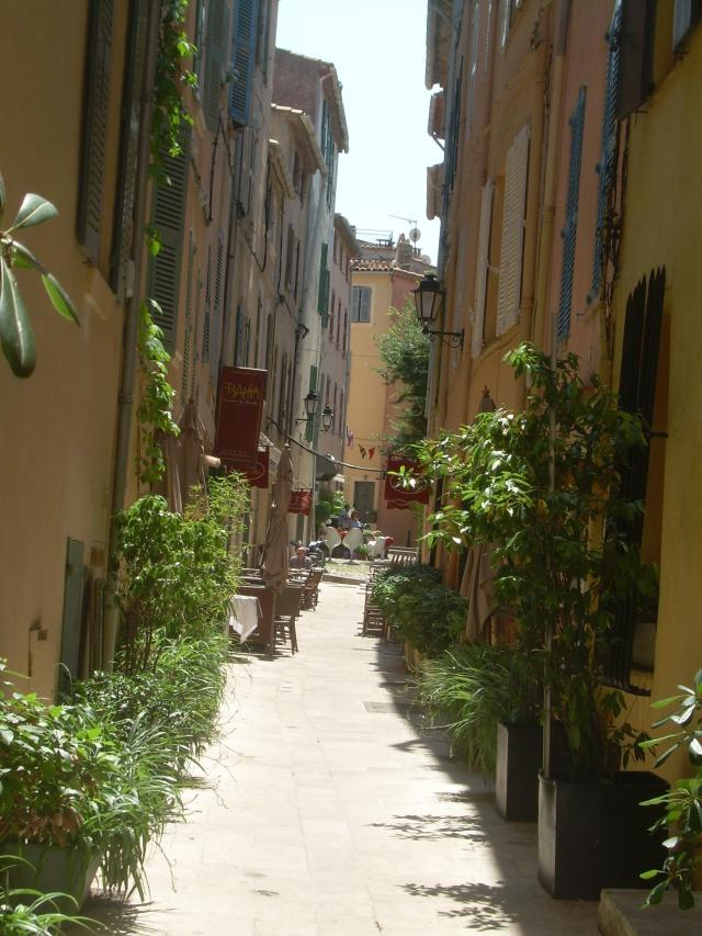 St. Trop. Narrow pathway with houses.