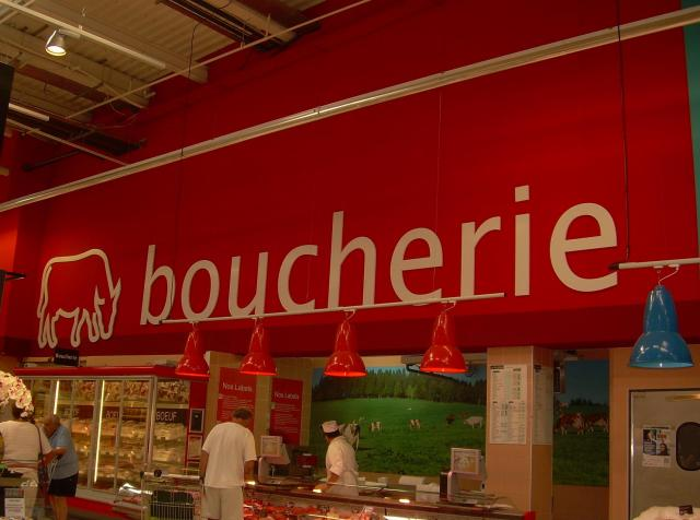 Theoule. Geant. Vincent picking out meat.