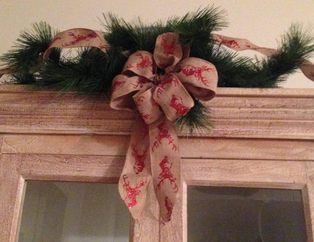 Decorations. Cabinet detail with deer ribbon