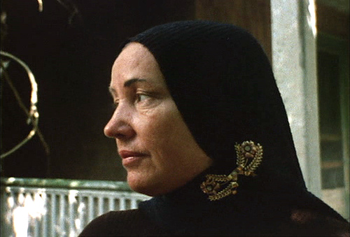 little edie in black headwrap and brooch
