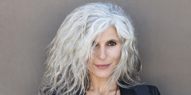 mature woman standing with grey hair