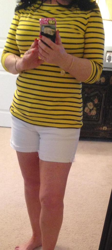 White shorts yellow and navy stripped shirt