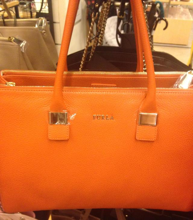 Orange Furla bag not you r color. Don't buy it!