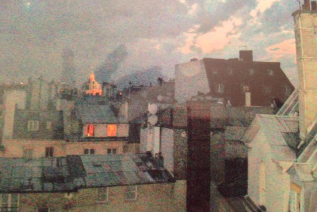 Rooftops at night from the salon window