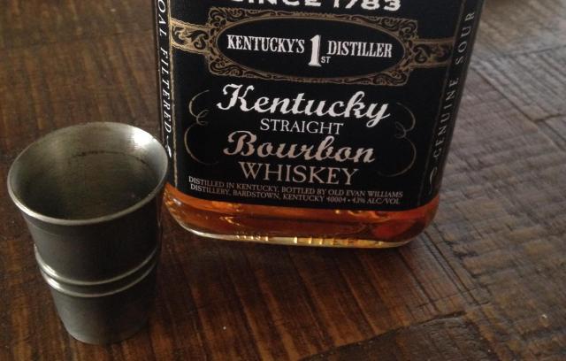 Shot glass and a burboun