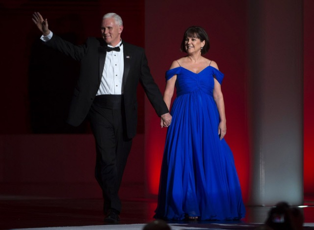 US Vice President Mike Pence, and his wife Karen arrive at the Liberty Ball at the Washington DC Convention Center following Donald Trump's inauguration as the 45th President of the United States, in Washington, DC, on January 20, 2017.  / AFP PHOTO / MOLLY RILEYMOLLY RILEY/AFP/Getty Images ORG XMIT: Inaugurat